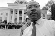 In today's world this would be considered a selfie/photobomb of Dr. King as state troopers stand shoulder to shoulder on the steps of Alabama's State Capitol (March 25, 1965), barring Dr. Martin Luther King, Jr. from entering.
