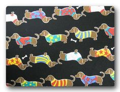 Dachshund in Dress on Black - Fabric By The Yard. $8.95, via Etsy.