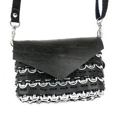 Cute as a button, this 5.5 by 4 inch bag fashioned from tire inner tube and soda tops has a 50-inch adjustable and removable fabric shoulder strap. Features a magnetic stud closure and lined with an i