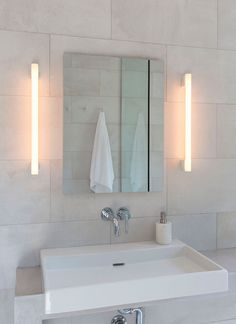 The basin faucet is the Atrio Wall-Mounted Faucet by Grohe. Jeff Madalena and Jason Gnewikow Brooklyn Brownstone by Poul Ober