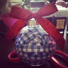 I made my own Wizard of Oz Christmas ornament this year out of blue gingham paper and red sparkly ribbon! #noplacelikehome #wizardofoz #DIYChristmas