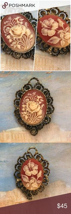 """Large Vintage Double Sided Floral Cameo Pedant Large and very unique double sided floral cameo pendant. Dark gold tone ornate metal frame surrounds intricate carved flower cameo.  Each side is different, the front features an orate carved rose while the back is a detailed carved Lily.  In nice vintage condition, although upon close inspection some glue is seen on the back cameo.  Measures 3"""" x 2"""". Vintage Jewelry Necklaces"""