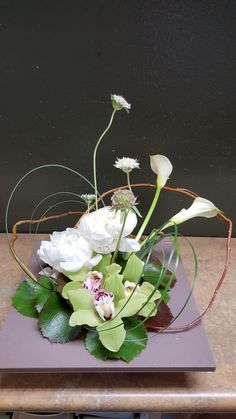 Green and white flower arrangements for wedding and event.