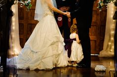 Sometimes when you need a hug it just can't wait<3 My husband and I saying our vows while our daughter and flower girl, Lilly, hugs her daddy's leg. Photo by Bert Reed Photography.