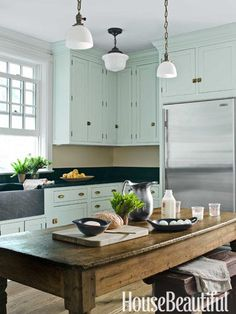 Humble and Homey Kitchen Farmhouse Kitchen, Shaker-style cabinets by Plain & Fancy, painted Teresa's Green by Farrow & BallFarmhouse Kitchen, Shaker-style cabinets by Plain & Fancy, painted Teresa's Green by Farrow & Ball Mint Green Kitchen, Green Kitchen Cabinets, Farmhouse Kitchen Cabinets, Kitchen Paint, Kitchen Colors, Farmhouse Table, Blue Cabinets, Rustic Table, Rustic Wood