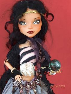 https://flic.kr/p/dSGg7S | Magic woman - Monster High repaint | Originally Cleo turned into a gypsy fortune teller. Holding a green crystal ball.