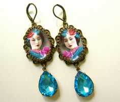 Another in my series of Uber colorful jeweled ladies. SO lovely. These have some heft. Not too much. About 2 inches long. Luxe and luscious aqua 18x13mm pear jewel hangs from digital collage hand altered by myself.  Necklace and pin coming soon!  Ships in 2-3 business days or LESS!     Follow me on Pinterest! : https://www.pinterest.com/PerBijoux/  And like me on Facebook for notice of new items, giveaways, coupon codes and more! : https://www.facebook.com/P...