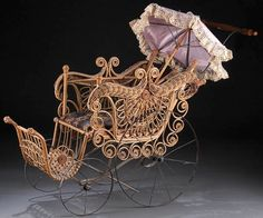 A VICTORIAN BENT WICKER DOLL BUGGY (circa 1900) w