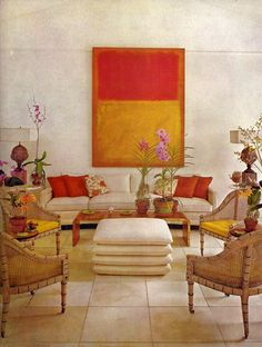 Almost Indian feel, wonderful balance in the painting and accents. Usually such bold colors create a busy room, but not so here. Also love the symmetry. It's balanced without feeling OCD.