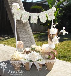 this would make a cute table center!i like the liitle lace flags on top