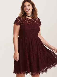 """A totally sophisticated skater dress - you can wear it to a cocktail party - with a skin-baring cutout back - that's totally primed for when your date asks if you """"want to get out of here?"""" The burgundy lace is all class with a fully lined slip, while the illusion neck teases what's to come on the back.<div><br></div><div><b>Model is 5'9.5"""", size 1<br></b><div><ul><li style=..."""