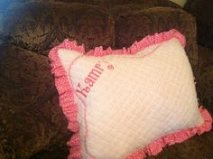Large embroidery pillow with soft and fluffy material--- This would be fantastic for sleepover camp.