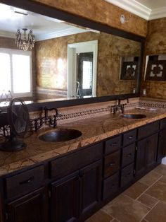 Beautiful refinished and custom stained cabinets,marble counter top, custom mirror, mirror frame and backsplash done, installed and designed by 714 Flooring Inc. Anaheim Hills Ca. Love how this master bathroom turned out!