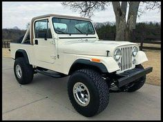 Jeep Scrambler - might have to paint mine white or Jamaican Beige one day