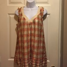 Brand new Calvin Klein baby doll shirt Brand new plaid baby doll top/ never worn/ tags attached/ very comfy and flowing Calvin Klein Tops Blouses