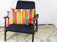 Textured Stripe is a large cushion cover in a stunning design by Tamasyn Gambell from the United Kingdom. Colors are red, mustard-yellow, brown-grey and light grey, and are screen printed using water-based inks onto European linen for a luxurious feel. The frontfeaturesthe Textured Stripe design and the back is the same fabric in plain light grey. Each cushion is cut from a different part of the cloth, so the pattern placement varies and no two cushions are the same. This is adds to the…