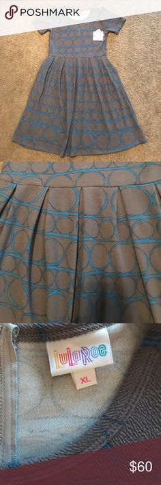 NWT Lularoe Amelia 👗 New Lularoe Amelia dress, size XL, grey background with a blue circular print. Very stretchy fabric, see sizing chart for sizing recommendations! ***PRICE IS FIRM BELOW RETAIL*** LuLaRoe Dresses Midi