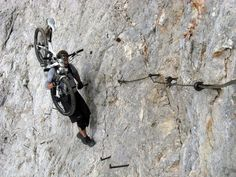 This biker is mixing two worlds, mountain bike and mountaineering (via ferrata).
