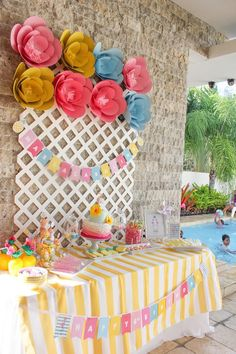 Party backdrop and paper flowers at a Flamingo Pineapple Birthday via karaspartyideas.com