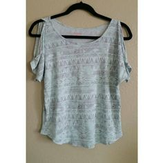 Open shoulder top Light blue open shoulder top with Aztec print like designs. Size M. Smoke free but not pet free home ?? ?? Tops Blouses