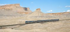 """Amtrak's California Zephyr in Utah. Amtrak's California Zephyr travels through the desert between Green River and Floy Utah"""" Book cliffs"""" """"photo by David Gubler"""" California Zephyr, California California, Green River, Tour Eiffel, Train Vacations, Scenic Train Rides, Westerns, Excursion, Destination Voyage"""