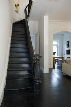 I love the stain on these stairs!  And the dark floors and neutral walls?  Perfect.