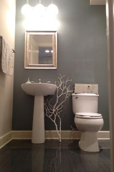 The Art Gallery Half bath color and d cor minus the weird tree LOL