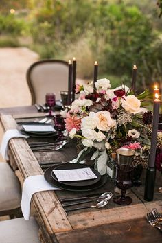 Halloween Wedding Table Setting Ideas With A Moody Haunted Wedding Tablescape With An Uncovered Table With A Moody Floral Centerpiece And Black Candles And Chargers And Colored Glasses Beautiful Table Settings, Wedding Table Settings, Place Settings, Romantic Table Setting, Outdoor Table Settings, Wedding Centerpieces, Wedding Decorations, Reception Table Decorations, Outdoor Decorations