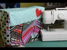 Learn how to custom make your own sewing machine cover! In this video I teach you how to take the measurements needed and translate them onto fabric to create a cute cover for your machine.  This is a great beginner project and requires only a few materials to create!  All you need is the fabric of your choice, fusible fleece (or batting/felt) a...