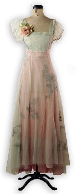 Spring Dance -Her dance card was full. Embroidery waltzes upon subdued layers of blush and celery. A French hem reveals pretty shoes with extended length in back. Sheer poofy sleeves, high waist, flattering bias-cut skirt and side zip.