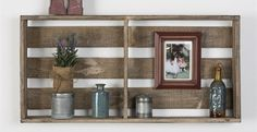 This shelf is made 100% out of reclaimed wood. We use old barn and fence wood and add a metal pole for your towels Measures 18 inch tall 36 inch wide4 inch deep