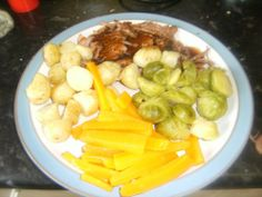 Roast lamb dinner with new potatoes and vegetables