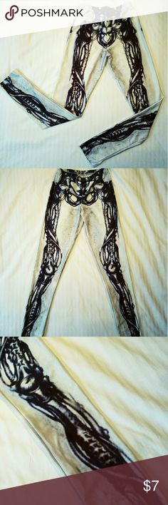 Halloween Skeleton Leggings Black and white graphic print leggings. Black/grey skeleton print on both sides. 88% polyester 12% spandex, so the material has a slight sheen. Worn twice, great condition. Perfectly goth & little creepy :) Pink Queen Pants Leggings
