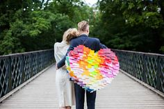 We love this colorful diy piñata made out of post it notes. See how to here...bklynbride.com #diy #pinata