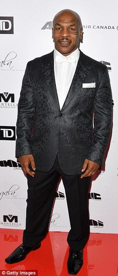 Dapper: The 50-year-old former Heavyweight Champion of the World: wore a patterned blazer over matching trousers and patent leather dress shoes  Mike Tyson.
