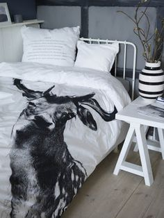 deer duvet cover. any design like this could make an impression. color coordinated. vase pretty.