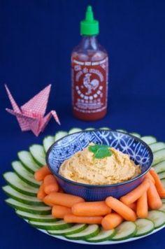 Sirrachi hummus:1 15oz. can of chickpeas (drained) 3 tbsp. sriracha sauce 3 tbsp. tahini 3 tsp. lemon juice 1/2 tsp. garlic powder a heavy pinch of salt 4 tsp. canola oil 1 tbsp.   water (optional)
