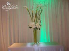 Calla lily with curly willow and rhododendron centerpiece