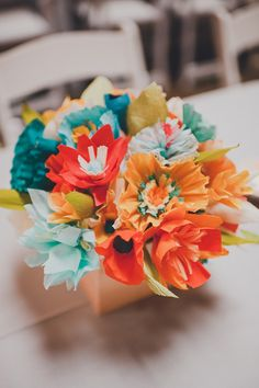 paper flower centerpiece, photo by Carina Skrobecki http://ruffledblog.com/seattle-art-gallery-wedding #weddingcenterpieces #paperflowers