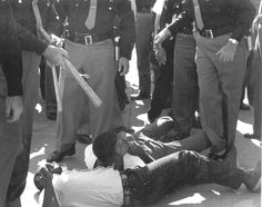SNCC Field Secretaries Avery Williams and Chico Neblett arrested for trying to bring water to voter applicants waiting for hours in line at the courthouse. Selma, Alabama, October 1963.