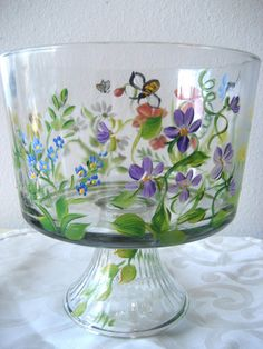 This 10 inch tall trifle bowl on a pedestal is painted with my wildflower pattern. This pattern complements any decor.  Signed and copyright by artist.  Delicate poppies sway in the breeze while violets. daisies and dandelions complete the English country garden on glass. This would be a delightful birthday gift or housewarming gift. Personalized for free.  Hand wash , fired for durability.