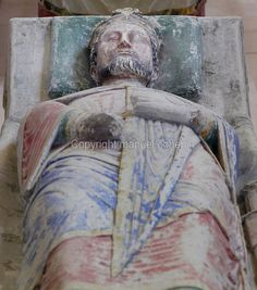 Died: 6th March, 1199. Royal tomb of Richard the Lionheart in the nave of the Abbey Church at Fontevraud Abbey, Anjou, France. Richard the Lionheart, son of King Henry II and Eleanor of Aquitaine, ruled as King Richard I of England 1189-1199. As a member of the House of Plantagenet, he was a benefactor of the monastery. His heart was buried at Rouen cathedral and his body buried here, although his remains were scattered by Huguenots in 1562 when the Abbey was sacked.