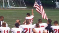 FREEDOM: WHEN NATIONAL ANTHEM SOUNDS, PLAYER WALKS TO CENTER OF FIELD THEN PARENTS SEE WHAT'S IN HIS HAND