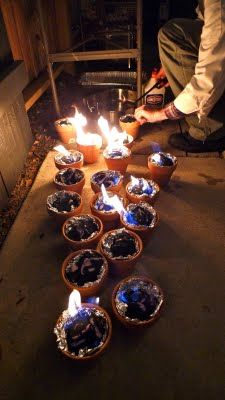 Charcoal lit in terra cota pots lined with foil. For table-top smores