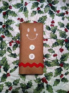 Gingerbread Men Candy Bar Wrappers.  Aren't they cute? We just wrapped the bars in brown packing paper and folded the top back to make the head look more rounded. Then we drew the face on with a paint (Chocolate Regalo Candy Canes)