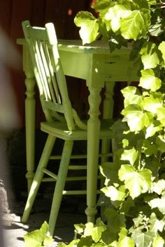 yellow-green table, chair and plants. Colored furniture is in style and an easy way to upcycle out of date furniture