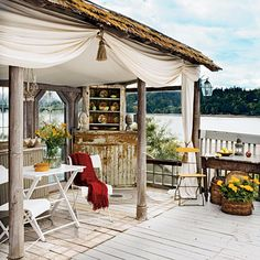 Outdoor Living Space: Previous owners built an outdoor room at the end of the main-level deck as a windbreak. The space is outfitted with a hutch, buffet, chandelier, and draperies to make it a comfortable extension of living space.