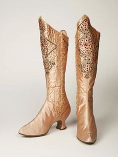 Pink silk satin stage Boots worn by the music hall variety artiste Kitty Lord, 1895-1914.