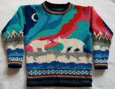 A hand knit sweater for littles who love the Northern Lights and polar bears.