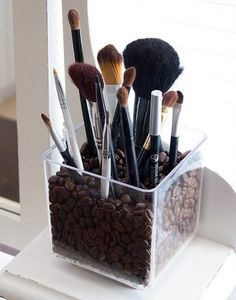 Use coffee beans and a clear container to store your makeup brushes! Great coffee smell and the perfect storage solution!